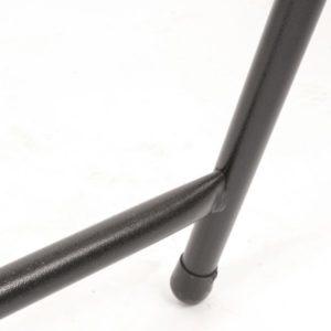 Black metal exam table leg close up