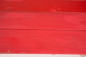 Red painted trestle table texture