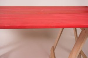Red painted trestle table edge