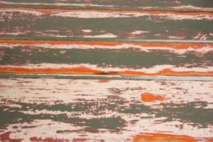 Vintage green and red timber trestle table texture
