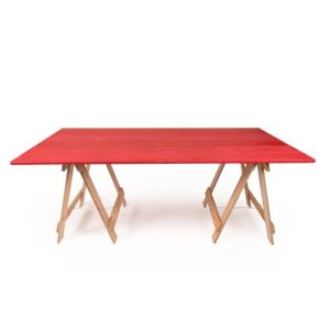 Red painted trestle table with raw plywood timber legs