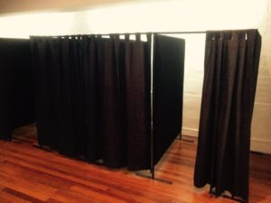 Change rooms in a row with grey curtains