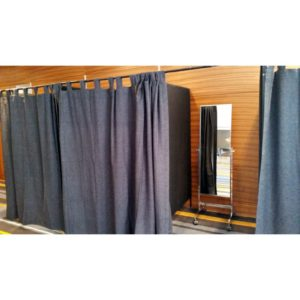 Change rooms with grey curtains and a mirror inside