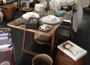 Kauri Pine trestle table with various items on top