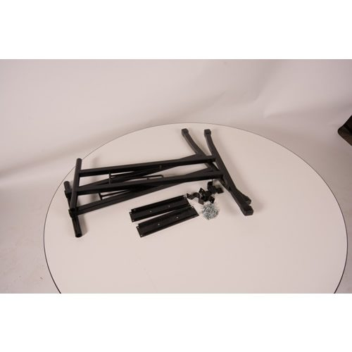 Pair of black metal T shape legs with plates, saddles and screws on top of a round, white maline table top