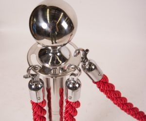 Top of chrome bollard, with red rope hanging off