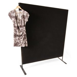 Black partition with a dress hanging off the side