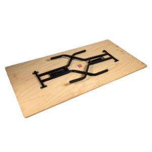Underside of plywood timber folding table with black wine glass shape legs folded down