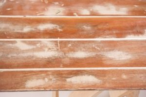Reclaimed white wash timber trestle table texture