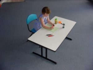 Child sitting and working at Kids Folding Table