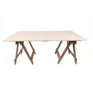 Cream trestle table top on brown timber trestle legs