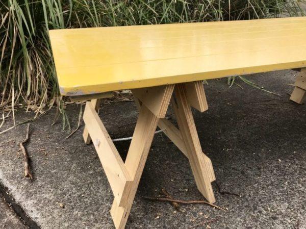 Yellow trestle table top on plywood boho style trestle leg