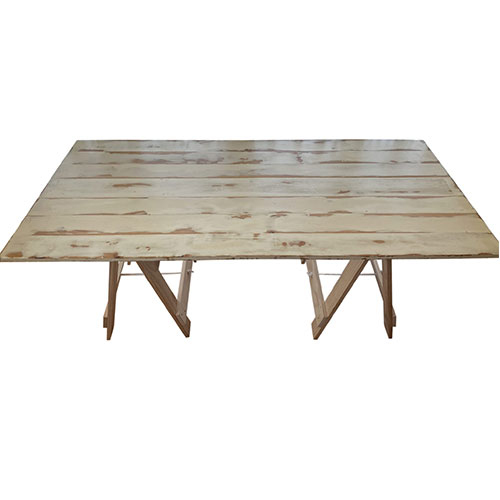 washed pine folding trestle table with a varnished table top and raw solid pine legs
