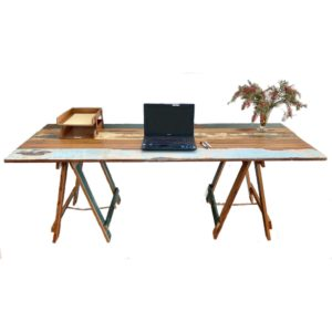 Reclaimed painted timber trestle table with laptop and paper holder on surface