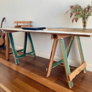 Reclaimed painted timber trestle table with green painted trestle legs