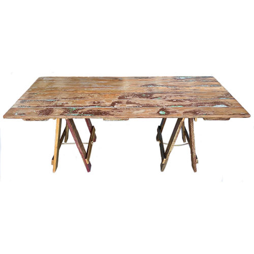 Recycled timber door trestle table with original paint and a coat of varnish