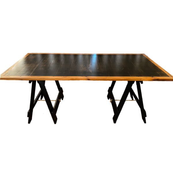 Stained Pine Table trestle table top with Oregon timber border on two black painted trestle legs.