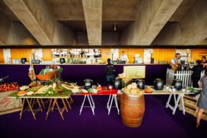 Various wooden trestle tables used in the Sydney Opera House. Buffet style food is on each of the tables