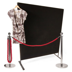 Black partitions and red rope barrier for hire